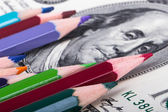 Pencils on Dollar Banknote — Stock Photo