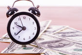 Alarm Clock and Banknotes — Stock Photo