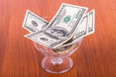 Dollar Banknotes in Glass Bowl — Stock Photo