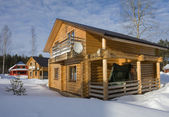 Wooden house in winter — Stock Photo