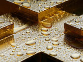 Water drops on gold — Stock Photo