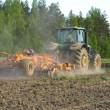 Arable land, sow seed on the tractor — Stock Photo #48219895