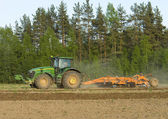 Arable land, sow seed on the tractor — Stock Photo