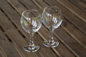 Glass goblets on wooden table — Stock Photo