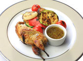 Roast chicken, quail on a platter — ストック写真