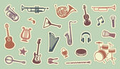 Stickers of musical instruments — Stock Vector