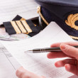Airplane pilot filling in flight plan — Stock Photo