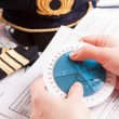 Stock Photo: Airplane pilot filling in flight plan