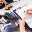Airplane pilot filling in flight plan - Stock Photo