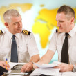 Airline pilots filling in papers in ARO — Stock Photo #21517119