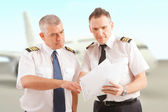 Airline pilots at the airport — Stock Photo