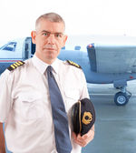 Airline pilot at the airport — Stock Photo