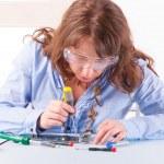 Woman fixing computer parts — Stock Photo