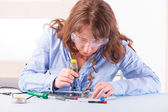 Woman fixing computer parts — Stock Photo
