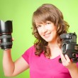 Photographer with camera and lens — Stock Photo