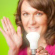 Woman with bulb — Stock Photo