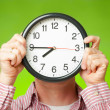 Clock covering face — Stock Photo