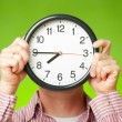 Stock Photo: Clock covering face
