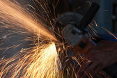 Cutting metal with grinder — Stock Photo