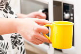 Opening the microwave oven — Stock Photo