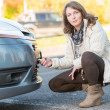 Woman assembling towing hook — Stock Photo