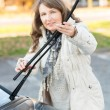 Woman picking up windscreen wiper — Stock Photo
