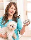 Woman feeding her dog — Photo