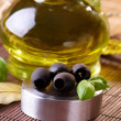Black olives and oil — Stock Photo #39164899