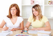 Students learning at desk — Stock Photo