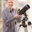Stock Photo: Man with telescope