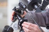 Adjusting telescope — Stock Photo