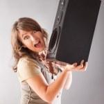 Beautiful woman holding big wooden speaker — Stock Photo