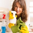 Beautiful young woman cleaning her house — Stock Photo