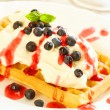 Waffles with fruits and whipped cream — Stock Photo