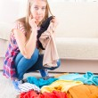 Young girl preparing her luggage — Stock Photo #41215113