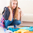 Young girl preparing her luggage — Stock Photo #41215119