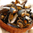 Mussels in basket — Stock Photo