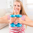 Stock Photo: Young womwith dumbbells