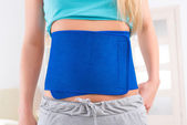 Woman wearing slimming belt — Stock Photo