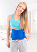 Woman wearing slimming belt — Stock Photo