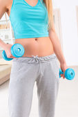Woman with dumb bells — Stock Photo