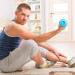 Stock Photo: Handsome mholding dumb bells