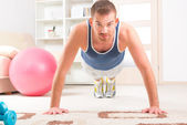Handsome man doing push ups — Stock Photo