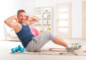 Handsome man doing sit ups — Stock Photo