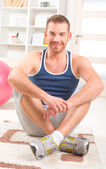 Handsome mandoing exercises at home — Stock Photo