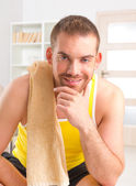 Handsome man resting after workouts — Stock Photo