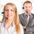 Happy Telephone Operators in call center — Stok fotoğraf