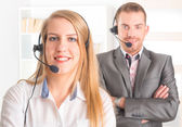 Happy Telephone Operators in call center — Stock Photo
