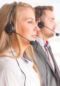 Happy Telephone Operators in call center — Foto Stock