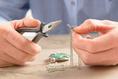 Creating or fixing jewelry — Stock Photo